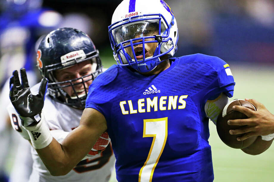 Buffalo quarterback Frank Harris makes the end zone just ahead of Bronco linebacker Brandon Smyth to get the winning touchdown as Clemens plays Brandeis in the second round of the 6A Division II playoffs  on November 20, 2015. Photo: TOM REEL, STAFF / SAN ANTONIO EXPRESS-NEWS / 2015 SAN ANTONIO EXPRESS-NEWS