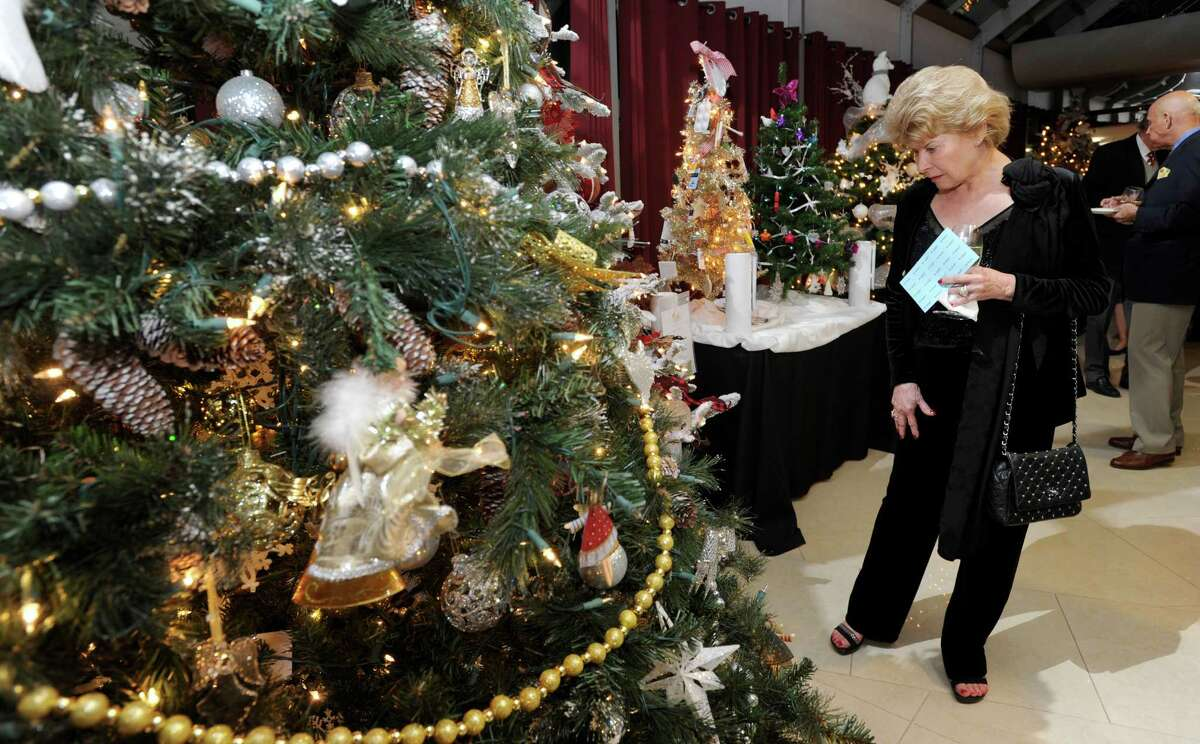 Nancy Alshuk of Danbury looks at the decorated trees displayed for the Ann's Place Festival of Trees at the Matrix Center Thursday night, Nov. 19, 2015. The three-day event is a fundraiser for the cancer support organization.