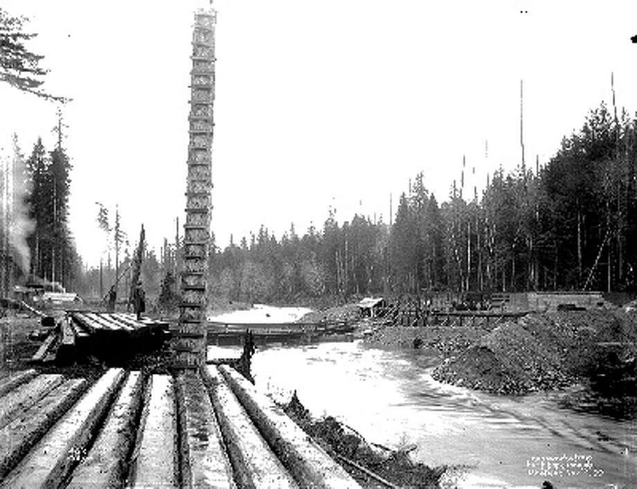 The Landsburg Dam and intake, shown here during construction in 1899, were far enough up the Cedar River to provide not only a clean water supply, but also enough pressure to have water flow 35 miles away at the top of Queen Anne Hill. Photo courtesy Seattle Municipal Archives. Photo: Courtesy Seattle Municipal Archives