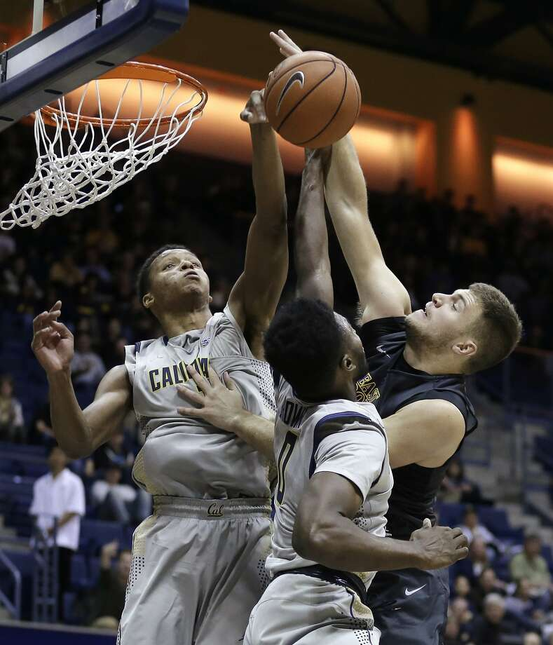 East Carolina's Michael Zangari shoots against Cal's Ivan Rabb (left) and Jaylen Brown. Photo: Ben Margot, Associated Press