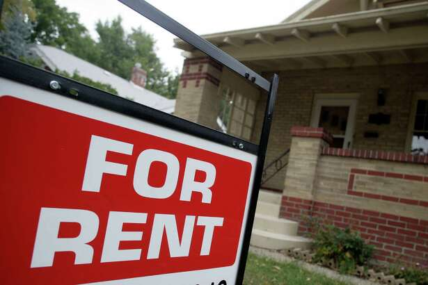"FILE - In this Sept. 24, 2007 file photo, a ""for rent"" sign is posted outside a home in Denver. U.S. home rental prices rose at a slower pace in October, a possible sign that apartment costs are testing the upper reaches of renters' incomes. Real estate data firm Zillow said Friday, Nov. 20, 2015 that median rents increased a seasonally adjusted 4.5 percent from a year ago. (AP Photo/David Zalubowski, File)"