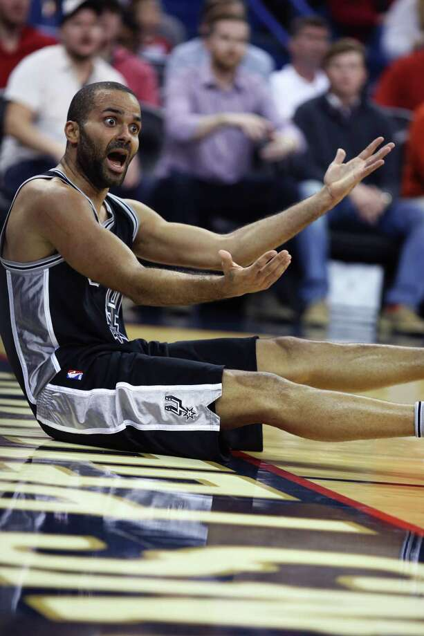 San Antonio Spurs guard Tony Parker (9) reacts after falling during a drive to the basket in the second half of an NBA basketball game in New Orleans, Friday, Nov. 20, 2015. The Pelicans won 104-90. (AP Photo/ Max Becherer) Photo: Max Becherer, Associated Press / FR171354 AP