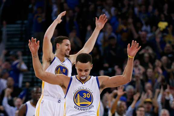 OAKLAND, CA - NOVEMBER 20:  Stephen Curry #30 and Klay Thompson #11 of the Golden State Warriors celebrate after Harrison Barnes #40 made a three-point basket late in the fourth quarter of their game against the Chicago Bulls at ORACLE Arena on November 20, 2015 in Oakland, California.  NOTE TO USER: User expressly acknowledges and agrees that, by downloading and or using this photograph, User is consenting to the terms and conditions of the Getty Images License Agreement.  (Photo by Ezra Shaw/Getty Images)