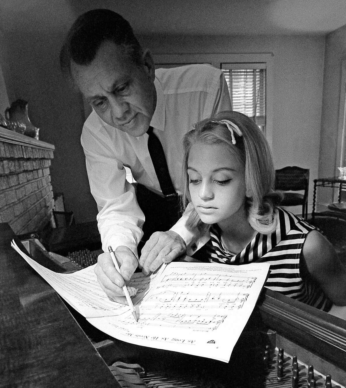 Goldie Hawn, born Nov. 21, 1945 in our nation's capital, grew up under the tutelage of her musician father and dance instructor mother. Here in 1960, at the piano with her father, musician and bandleader Edward Rutledge Hawn, the future dancer and actress looks over sheet music for