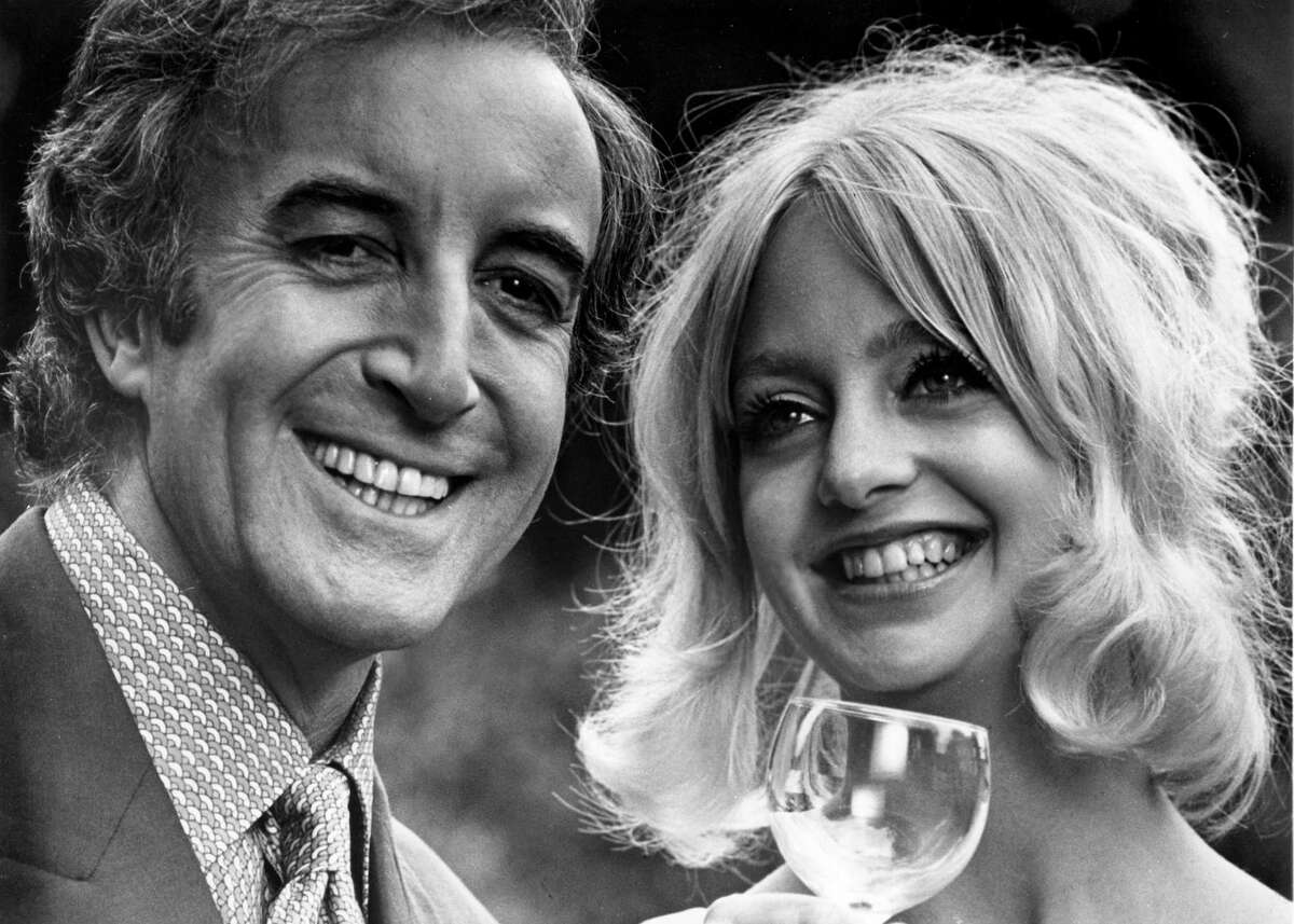 1970: Peter Sellers smiles with Goldie in a scene from the movie