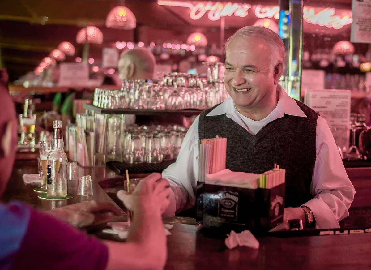 Bartender Jose Nieto talks with a customer at Uncle Charlie's bar in San Francisco, Calif. on Friday, November 20th, 2015.