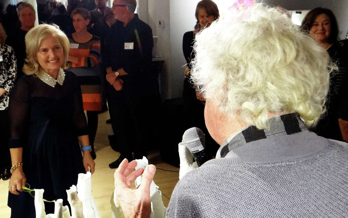 Photographer Larry Silver expresses thanks on behalf of local artists to Westport Arts Center Artistic Director Helen Klisser During at the opening of the