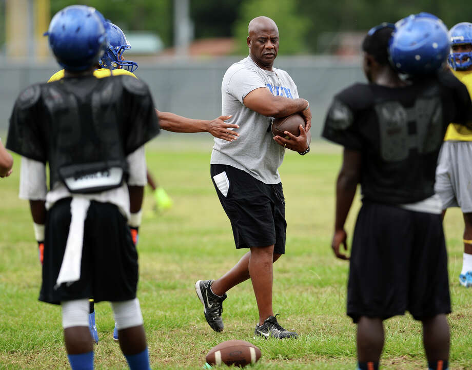 Coach David Suggs directs players during drills at Tuesday's practice. The Ozen High School football team practiced Tuesday afternoon at the school. Photo taken Tuesday 5/27/14 Jake Daniels/@JakeD_in_SETX Photo: Jake Daniels / ©2014 The Beaumont Enterprise/Jake Daniels
