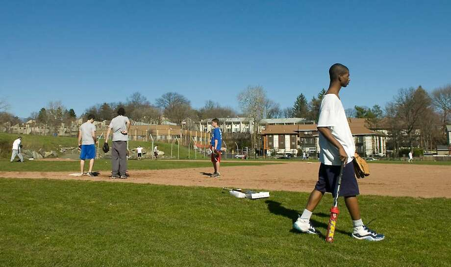 Boys tryout for the Stamford High School baseball team on the school's field in Stamford, Conn. on Wednesday, March 24, 2010. Photo: Kathleen O'Rourke / Stamford Advocate
