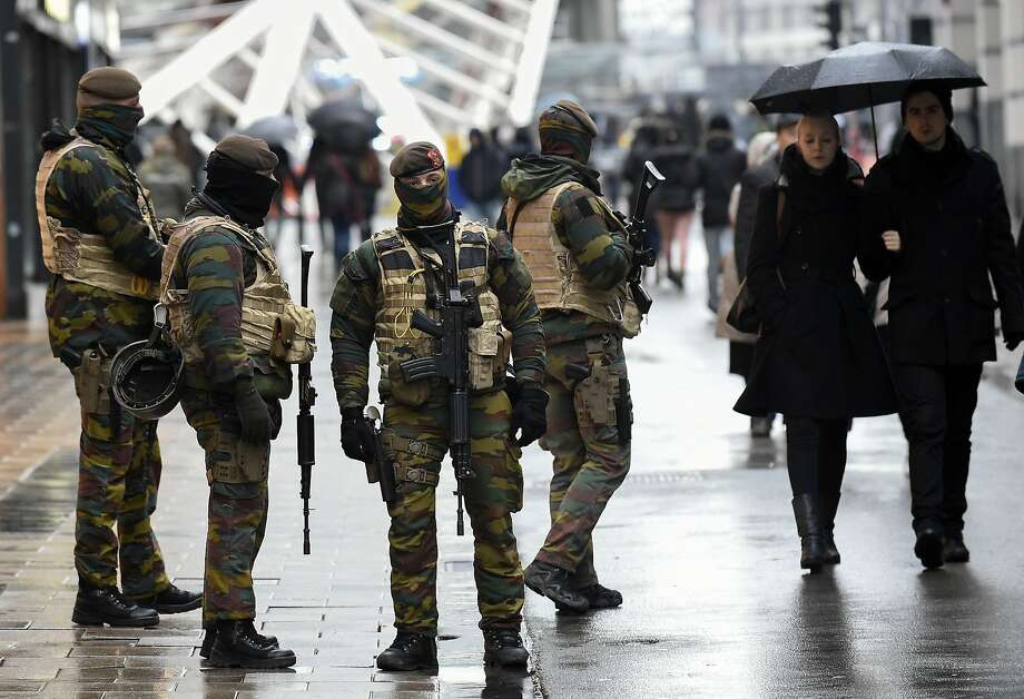 Soldiers patrol a pedestrian shopping district in Brussels after Belgium's national crisis center raised the terrorism alert level. Photo: John Thys, AFP / Getty Images