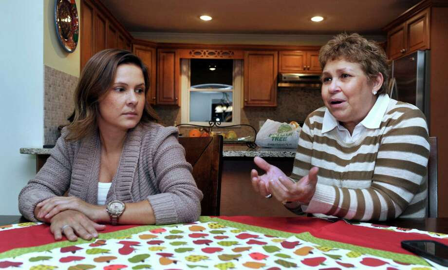 Roberta Gaiotti, 35, left, and her mother, Rita Kovacs, 59, discuss the impact of a devastating mining flood in their native country of Brazil. Photo: Carol Kaliff / Hearst Connecticut Media / The News-Times