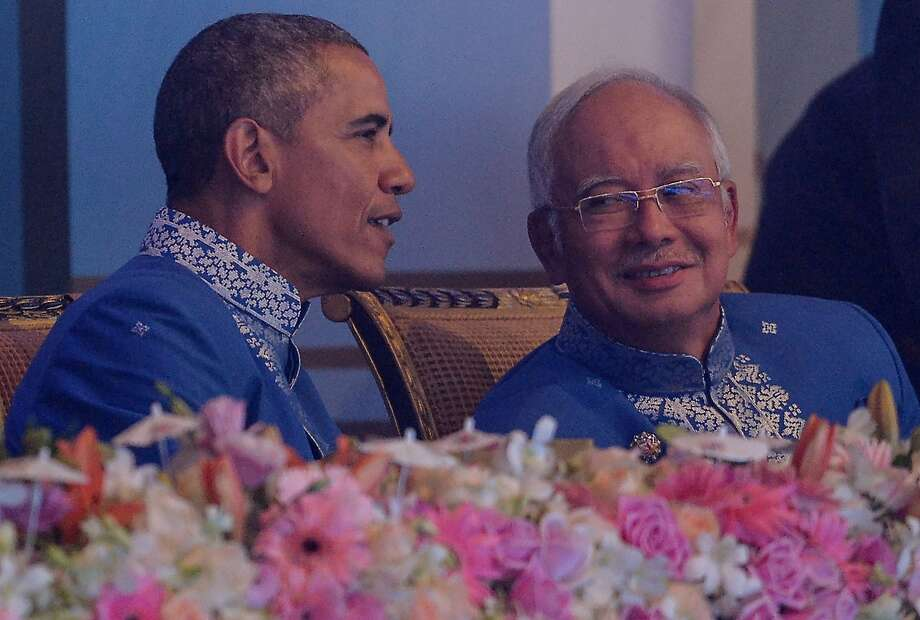 President Obama speaks with Malaysian Prime Minister Najib Razak at a dinner for Asia-Pacific leaders in Kuala Lumpur. Photo: Mohd Rasfan, AFP / Getty Images