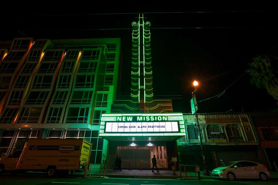People walk past the New Mission Theater as it lights up its 70-foot marquee, Thursday, Nov. 19, 2015, in San Francisco, Calif. Photo: Santiago Mejia, Special To The Chronicle