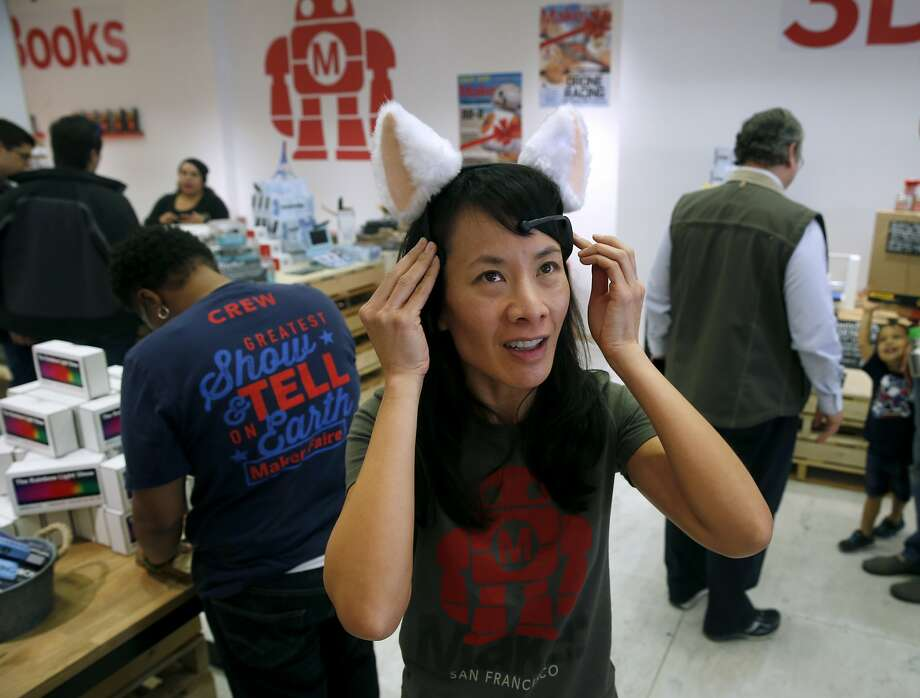 Sonia Wong, general manager of commerce for Maker Media, demonstrates the Brainwave Cat Ears at the Make magazine holiday pop-up store near Union Square in San Francisco, Calif. on Friday, Nov. 20, 2015. Photo: Paul Chinn, The Chronicle