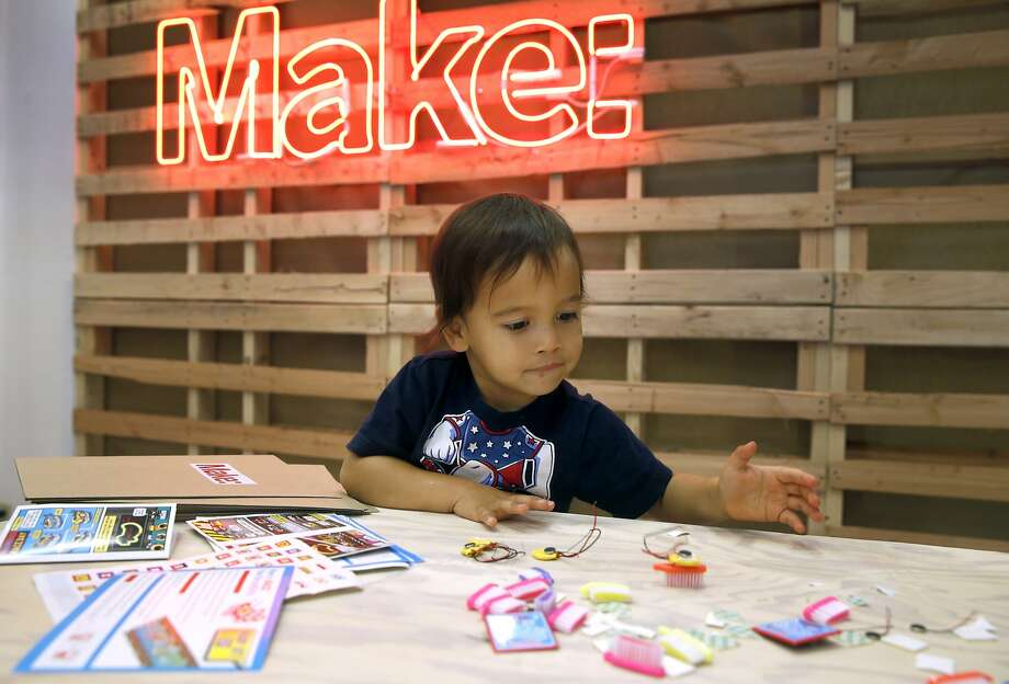 Johnny Haluck, 2, plays with a Brushbot which he helped assemble at the Make magazine holiday pop-up store near Union Square in San Francisco, Calif. on Friday, Nov. 20, 2015. Photo: Paul Chinn, The Chronicle
