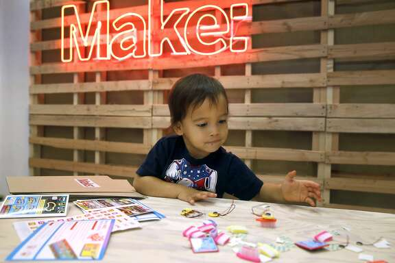 Johnny Haluck, 2, plays with a Brushbot which he helped assemble at the Make magazine holiday pop-up store near Union Square in San Francisco, Calif. on Friday, Nov. 20, 2015.