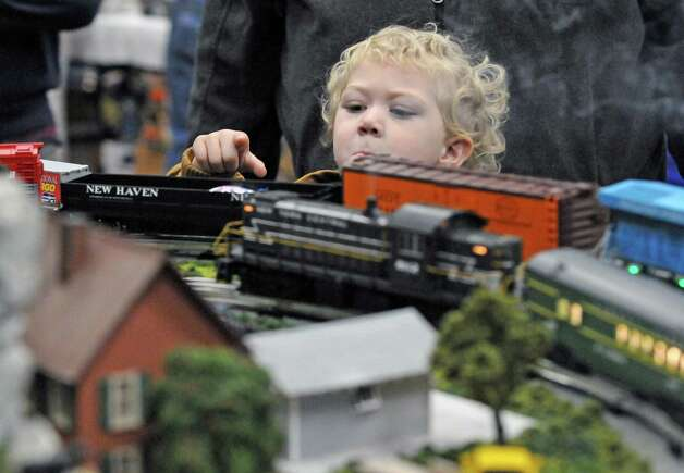 Three-year-old Hannah Sands of Westerlo checks out a model train display during the Albany Train Show at the Polish Community Center on Saturday Nov. 21, 2015 in Albany, N.Y. (Michael P. Farrell/Times Union) Photo: Michael P. Farrell / 00034247A