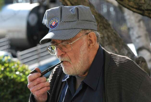 Model train repairman Doug Farley of East Schodack takes a break outside during the Albany Train Show at the Polish Community Center on Saturday Nov. 21, 2015 in Albany, N.Y. (Michael P. Farrell/Times Union) Photo: Michael P. Farrell / 00034247A