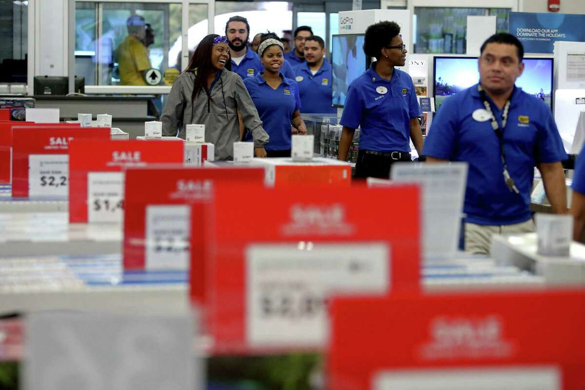 Employees enter the store to role play as customers at the dress rehearsal for Black Friday, one of the biggest days of the year, at the Best Buy along the 9700 block of Katy Freeway Saturday, Nov. 21, 2015, in Houston, Texas.