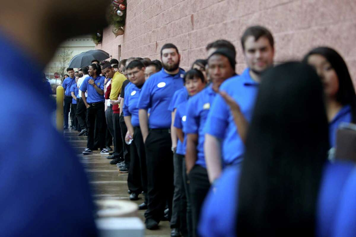 Over 100 employees line up to role play as customers at the dress rehearsal for Black Friday, one of the biggest days of the year, at the Best Buy along the 9700 block of Katy Freeway Saturday, Nov. 21, 2015, in Houston, Texas.