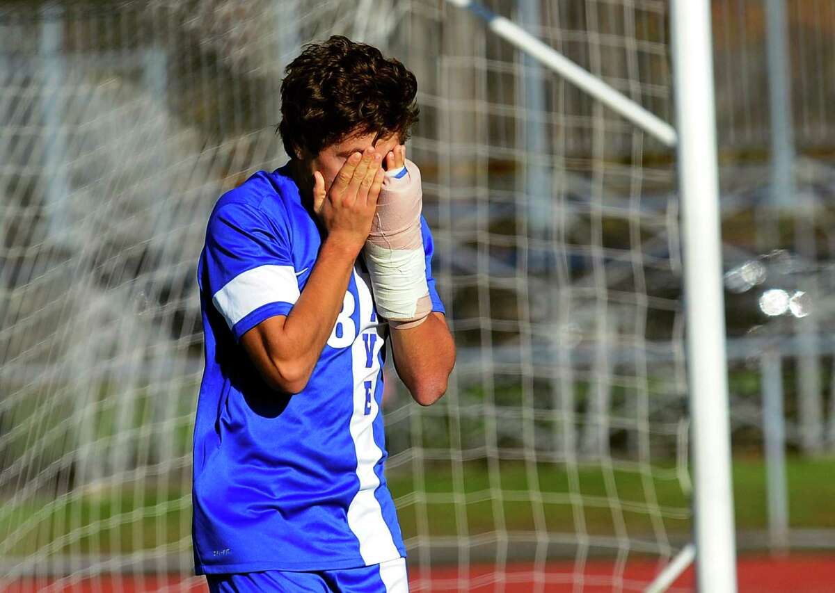 Darien's Pablo Martinez reacts after missing a goal during Class LL Boys Soccer Championship action against Glastonbury in West Haven, Conn. on Saturday Nov. 21, 2015.