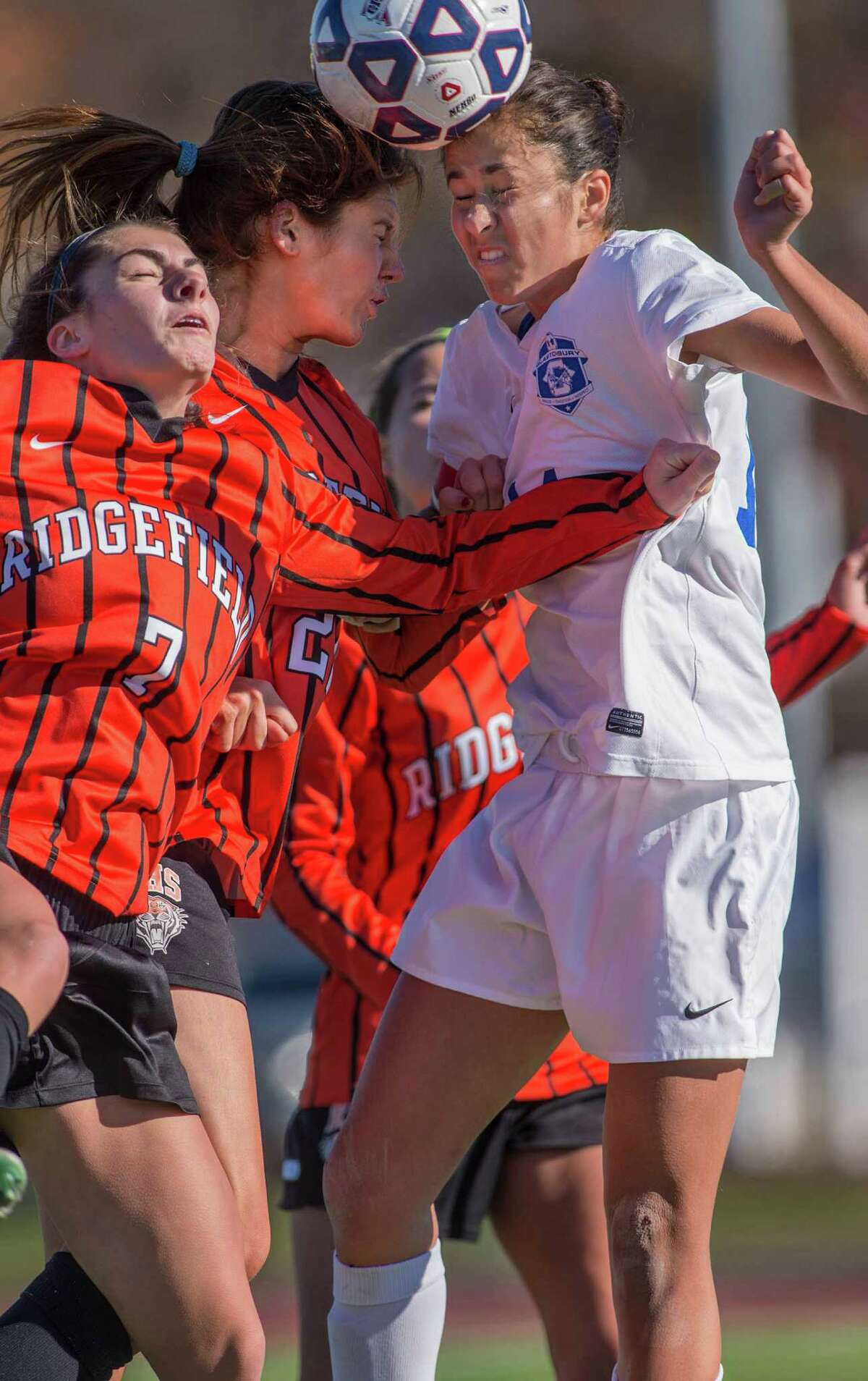 Ridgefield High Schools Sarah Battipaglia and Kathryn Barlow collide into Glastonbury High Schools Sabrina Glaser while trying to head the ball during the CIAC Class LL girls soccer championship game played at West Haven High School, West Haven, CT on Saturday, November 21, 2015.