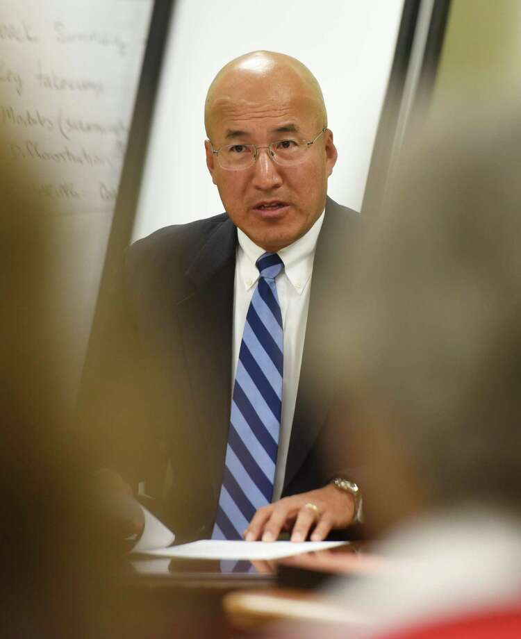 Suspended Greenwich High School band director John Yoon speaks during his hearing at the Greenwich Board of Education in Greenwich, Conn. Monday, Sept. 21, 2015. Yoon has been suspended after allegedly bullying two students last school year. Photo: Tyler Sizemore / Hearst Connecticut Media / Greenwich Time