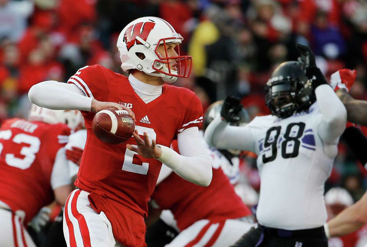 Wisconsin's Joel Stave looks to pass during the first half of an NCAA college football game against Northwestern Saturday, Nov. 21, 2015, in Madison, Wis. (AP Photo/Morry Gash)
