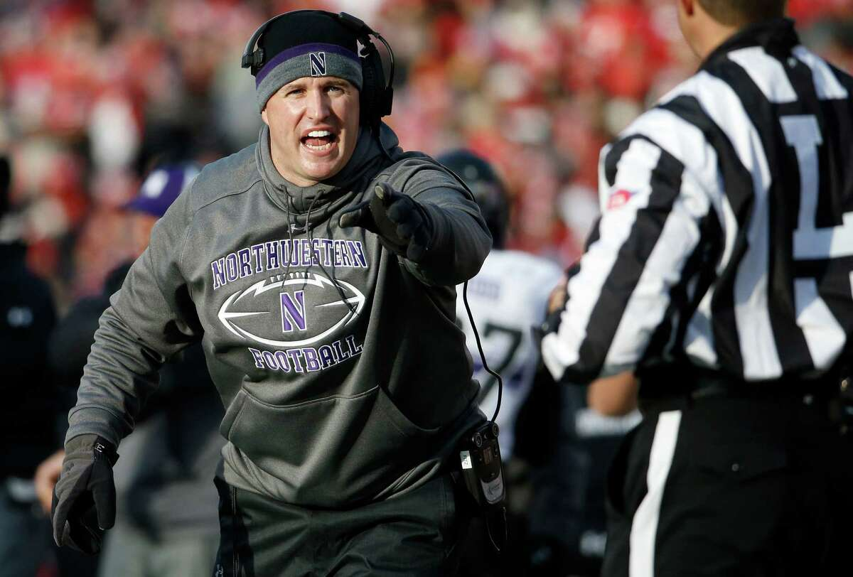 Northwestern head coach Pat Fitzgerald reacts to a call during the first half of an NCAA college football game against Wisconsin Saturday, Nov. 21, 2015, in Madison, Wis. (AP Photo/Morry Gash)