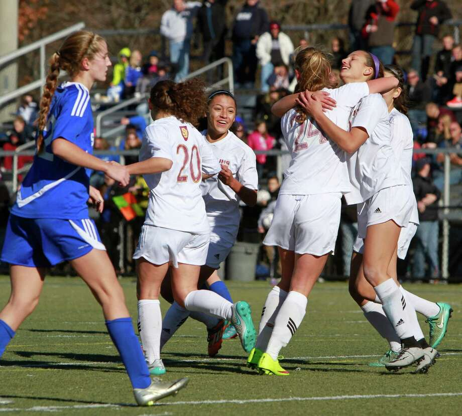 St. Joseph's Jenna Bike celebrates with Lindsey Savka after Savka scored in the second half against Suffield during the CIAC Class L championship on Nov. 21, 2015 in Waterbury. St. Joseph won 2-0. Photo: Matthew Brown / For Hearst Connecticut Media / Connecticut Post Freelance