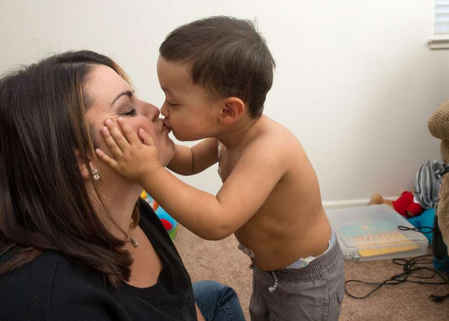 Xavier Pequeno kisses his mother Jessica Pequeno at their home in Napa, Calif., on Nov. 19, 2015. Photo: JOSH EDELSON / SAN FRANCISCO CHR
