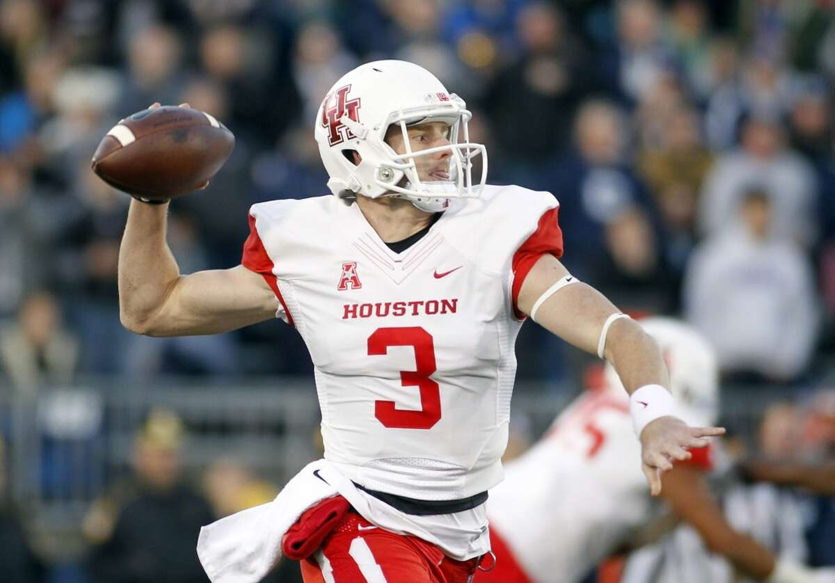 Houston quarterback Kyle Postma (3) throws a pass against Connecticut during the first quarter of an NCAA college football game, Saturday, Nov. 21, 2015, in East Hartford, Conn. (AP Photo/Stew Milne)