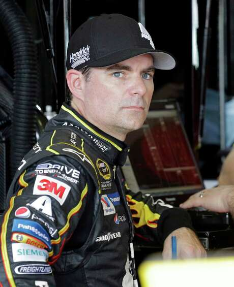 Jeff Gordon, who is retiring after today's race, was all business as he awaited Saturday's final practice session at Homestead, Fla. Photo: Terry Renna, FRE / FRE60642 AP