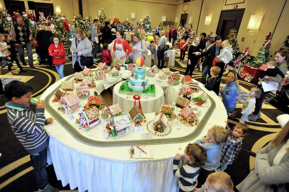 The Enchanted Forest featured incredible gingerbread houses, pictured, and themed Christmas trees.  Photo: Michael Cummo, Hearst Connecticut Media / Stamford Advocate