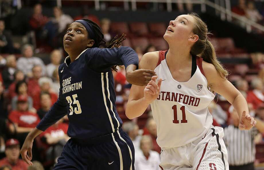 Stanford reserve Alanna Smith (right) and George Washington's Jonquel Jones (left) vie for a rebound. Photo: Ben Margot, Associated Press
