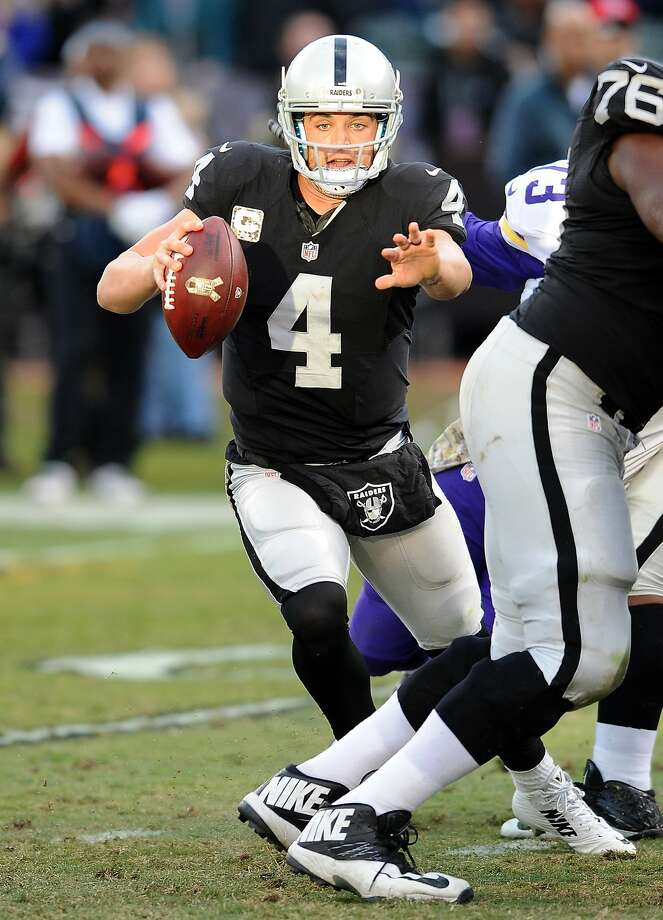 "Raiders quarterback Derek Carr (4), on the run against the Minnesota Vikings, expects the Lions to ""come out fired up."" Photo: John Cordes, Associated Press"
