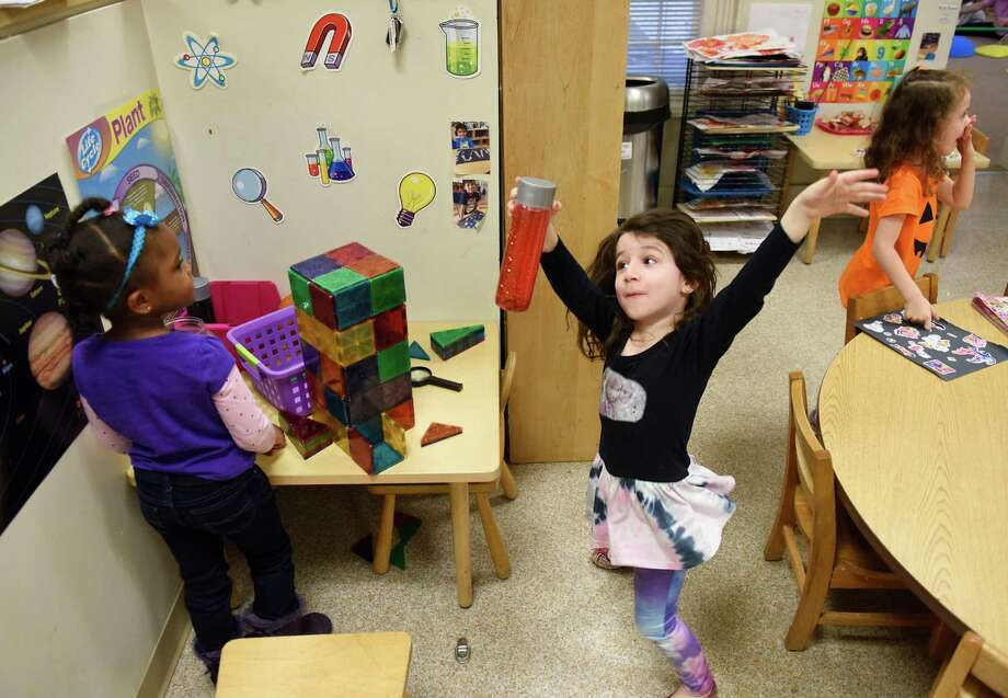 Maia Kelly, 4, shows off her dance moves to Ja'Kayla Hayes, left, 4, and Gabi Wright, 4, at Family Centers' Gateway School in Greenwich, Conn. Thursday, Nov. 19, 2015.  Many local nonprofits, like Family Centers, are experiencing an increase in need and a decrease in funding. Photo: Tyler Sizemore / Hearst Connecticut Media / Greenwich Time