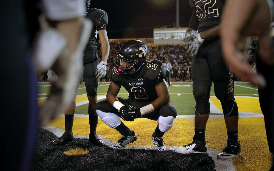 Antioch's star running back Najee Harris, 2 waits for the coin toss as the Panthers prepare to take on the Amador Valley Dons in Antioch, Calif., on Fri. November 20, 2015. Photo: Michael Macor, The Chronicle