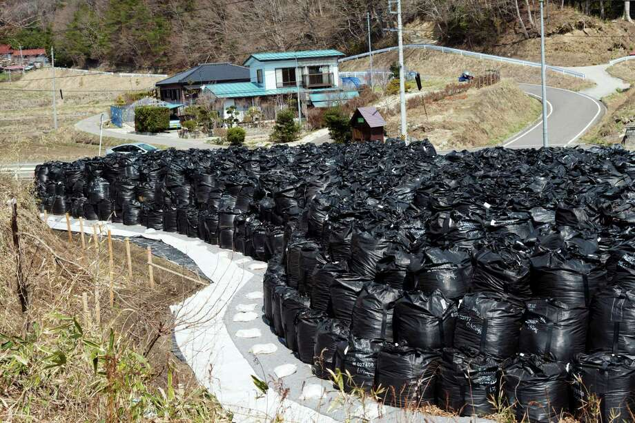 Bags of contaminated waste piled up in Miyakoji, a village near Fukushima, Japan, in 2014. The nuclear meltdown there is on the minds of rural Chinese. Photo: Ko Sasaki /New York Times / NYTNS