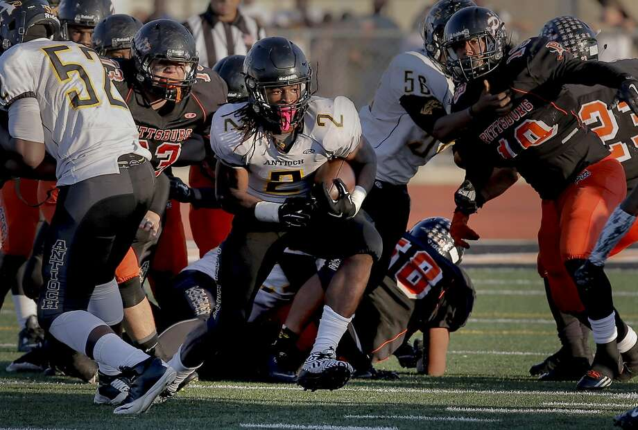 Antioch's Najee Harris, 2 breaks open on a run as the Pittsburgh High School Pirates went on to lose to the Antioch Panthers 44-42 in a cross town football rivalry in Pittsburgh Calif. on Sat. November 7, 2015. Photo: Michael Macor, The Chronicle