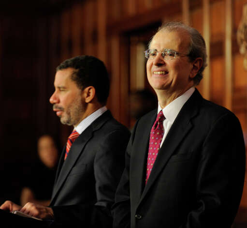 Judge Jonathan Lippman, right, smiles after being nominated as the new Chief Judge of the New York State Court of Appeals by Governor David Paterson, left, on Jan. 14, 2009, in the Red Room of the Capitol in Albany, N.Y. (Skip Dickstein/Times Union) Photo: SKIP DICKSTEIN / 00002047A