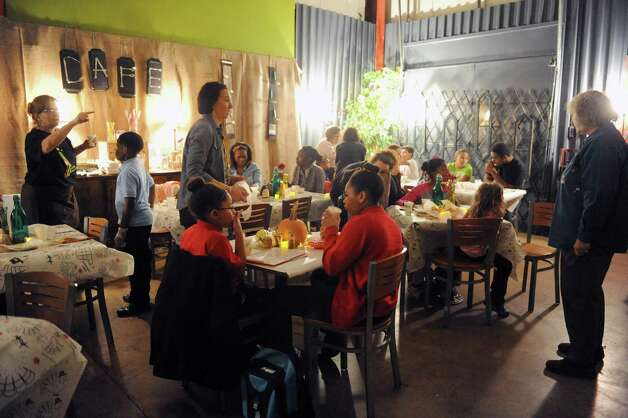 Children sit down for a full Thanksgiving style dinner during the South End Children's Cafe at the Reigning Life Family Church on Thursday Nov. 19, 2015 in Albany, N.Y. (Michael P. Farrell/Times Union) Photo: Michael P. Farrell / 10034320A