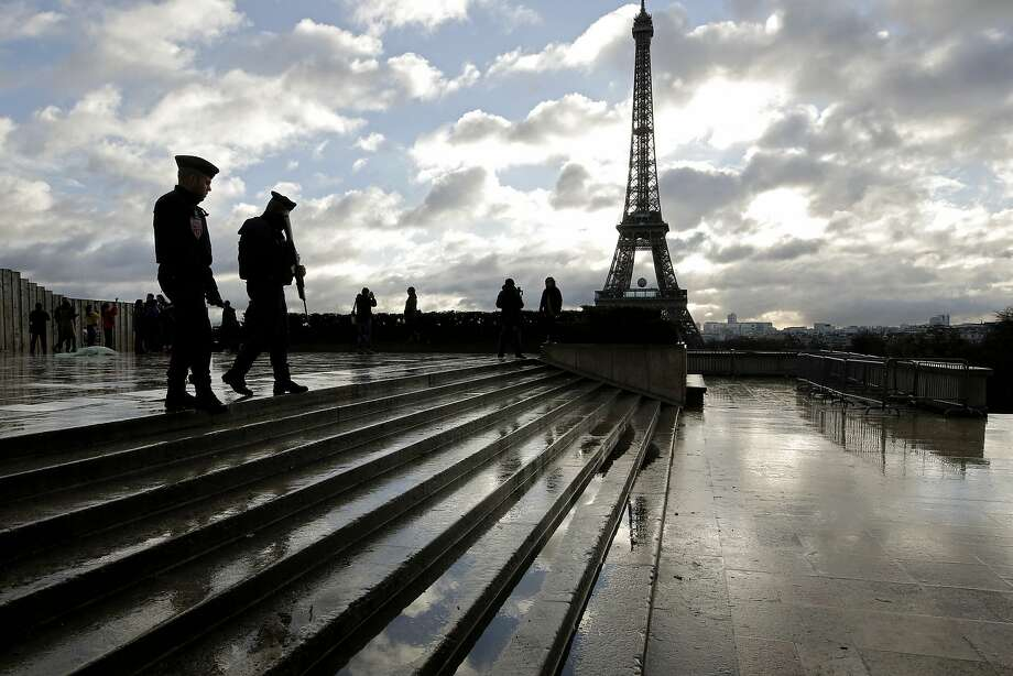 French soldiers patrol the Trocadero place near the Eiffel Tower, in Paris, Saturday, Nov. 21, 2015. French President Francois Hollande will preside over a national ceremony on Nov. 27 honoring the victims of the deadliest attacks on France in decades.  Photo: Laurent Cipriani, Associated Press