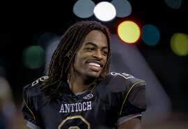 Antioch's star running back Najee Harris, 2 during a lighter moment before the Panthers take on the Amador Valley Dons in Antioch, Calif., on Fri. November 20, 2015.