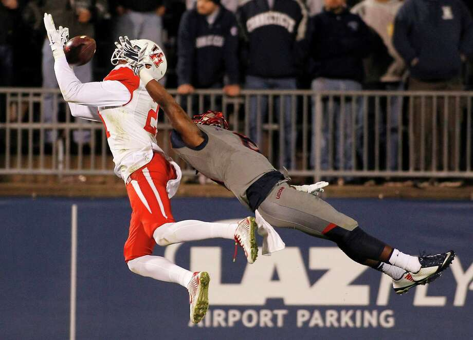 Keep clicking to take a closer look at UH's 2016 season. Houston wide receiver Chance Allen, left, catches a touchdown pass over the defense of Connecticut cornerback Jhavon Williams during the fourth quarter of an NCAA college football game Saturday, Nov. 21, 2015, in East Hartford, Conn. Photo: Stew Milne, Associated Press / FR56276 AP