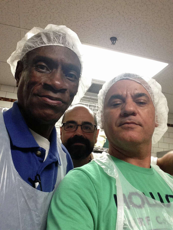From left to right, long time staff and former client of Pacific House Sidney Elmore, Baltazar Mendoza and Elton Sousa take a break from serving clients at the homeless shelter in Stamford that serves Greenwich residents. Photo: Silvia Foster-Frau / Hearst Connecticut Media / Greenwich Time