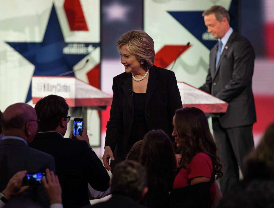 FILE - Hillary Rodham Clinton speaks to attendees of a Democratic debate in Des Moines, Iowa, Nov. 14, 2015. With the liberal wing of the Democratic party ascendant, Clinton's relationship with banks and financial services firms has become a major vulnerability for the former secretary of State. At right is Martin O'Malley, another candidate at the debate. (Ruth Fremson/The New York Times) Photo: RUTH FREMSON, STF / New York Times / NYTNS