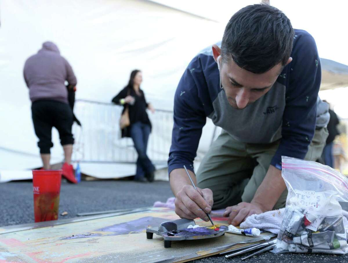 """Joseph Lakata, who moved from Pennsylvania a few months ago, works on a painting at Houston Whatever Fest Saturday, Nov. 21, 2015, in Houston. """"This is what I came here for,"""" he said. """"This is the happiest I've ever been in my life."""""""