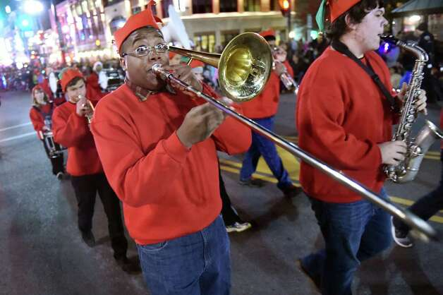 Zechariah Gainey, 17, plays trombone with the Schenectady High School Band as they march in the 48th Annual Daily Gazette Holiday Parade on Saturday, Nov. 21, 2015, in Schenectady, N.Y. (Cindy Schultz / Times Union) Photo: Cindy Schultz / 00033960A