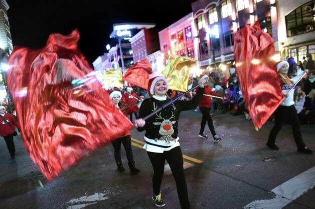 Draper Middle School flag twirlers perform during the 48th Annual Daily Gazette Holiday Parade on Saturday, Nov. 21, 2015, in Schenectady, N.Y. (Cindy Schultz / Times Union) Photo: Cindy Schultz / 00033960A